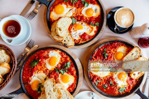 shakshuka served in frying pan, directly above view - gourmet stock pictures, royalty-free photos & images