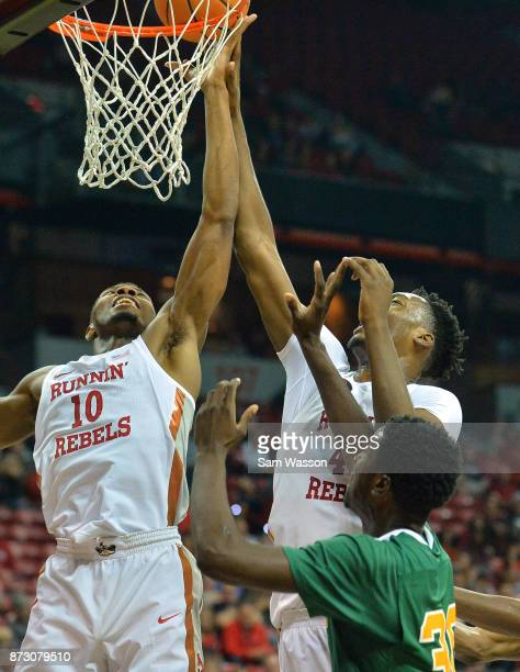 Shakur Juiston and Brandon McCoy of the UNLV Rebels battle Rashad Austin of the Florida AM Rattlers for a rebound during their game at the Thomas...
