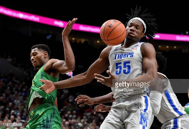 Shakur Juiston of the Oregon Ducks and Precious Achiuwa of the Memphis Tigers battle for a rebound during the second half of the game at Moda Center...