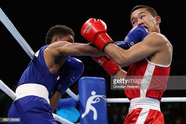 Shakur Stevenson of the United States throws a right on Tsendbaatar Erdenebat of Mongolia in the boxing Men's Bantam Quarterfinal 2 on Day 11 of the...