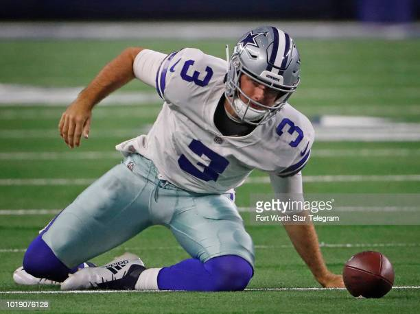 A shaky Dallas Cowboys quarterback Mike White gets to his feet after a hard hit hard by Cincinnati Bengals defensive end Jordan Willis in the fourth...