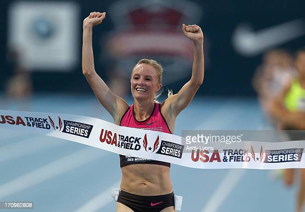 Shalane Flanagan celebrates as she crosses the finish line to win the Womens' 10,000 Meter on day one of the 2013 USA Outdoor Track & Field...
