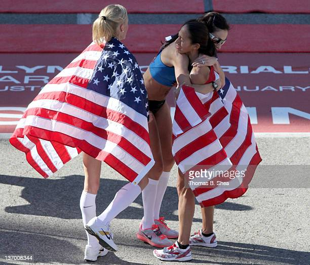 Shalane Flanagan Desiree Davila and Kara Goucher celebrate after they competed in the US Marathon Olympic Trials January 14 2012 in Houston Texas