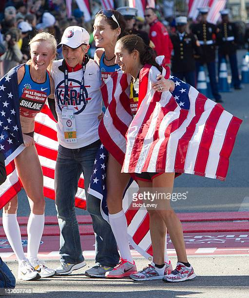 Shalane Flanagan Joan Benoit Samuelson Kara Goucher and Desiree Davila congratulate each other after the US Marathon Olympic Trials on January 14...