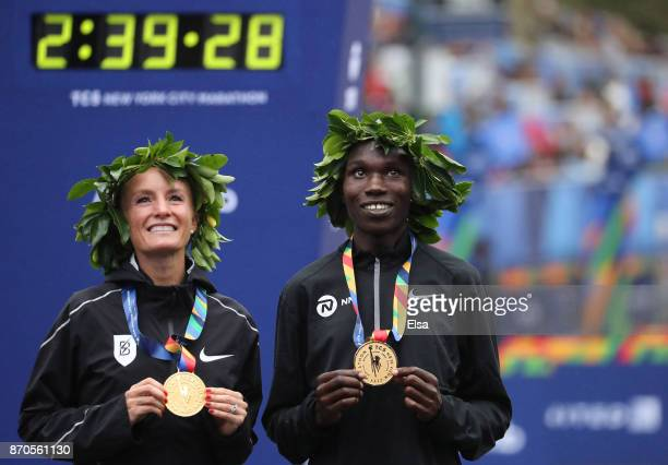 Shalane Flanagan of the United States and Geoffrey Kamworor of Kenya celebrate winning the Professional Divisions of the 2017 TCS New York City...
