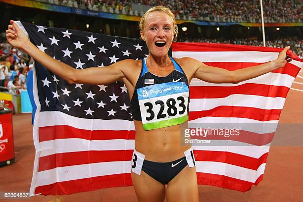 Shalane Flanagan of the United States celebrates third place in the Women's 10,000m Final and the bronze medal at the National Stadium on Day 7 of...