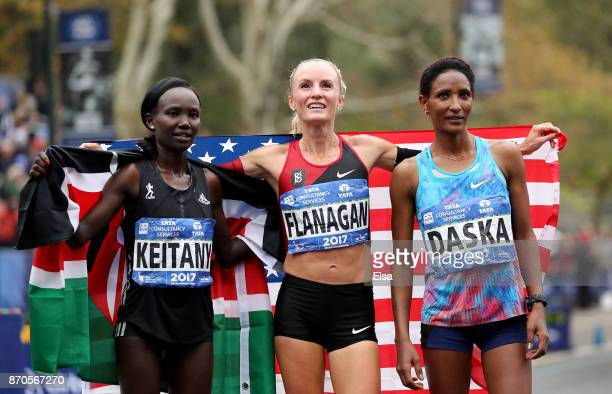 Shalane Flanagan of the United States celebrates winning the Professional Women's Division with Mary Keitany of Kenya and Mamitu Dasku of Ethiopia...