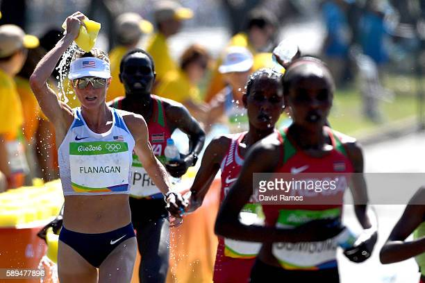 Shalane Flanagan of the United States pours water on her head during the Women's Marathon on Day 9 of the Rio 2016 Olympic Games at the Sambodromo on...