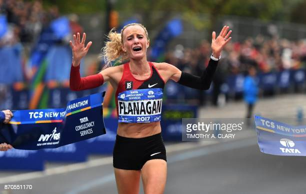 TOPSHOT Shalane Flanagan of the US celebrates after crossing the finish line to win the Women's Division during the 2017 TCS New York City Marathon...