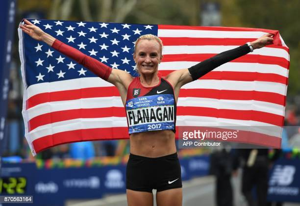 Shalane Flanagan of the US celebrates after she won the Women's Division during the 2017 TCS New York City Marathon in New York on November 5 2017...