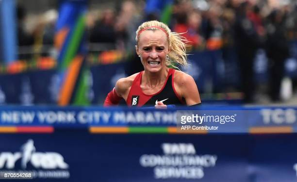 Shalane Flanagan of the US runs to the finish line to win the Women's Division during the 2017 TCS New York City Marathon in New York on November 5...