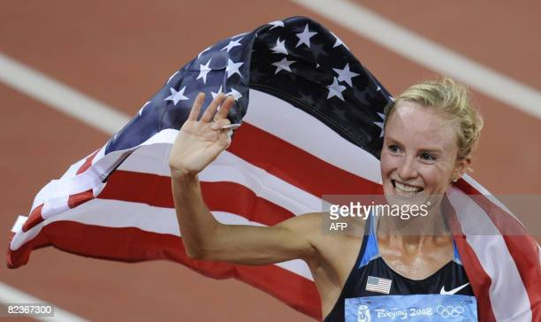 Shalane Flanagan of the US waves to supporters as she celebrates placing third in the women's 10000m final at the National stadium as part of the...