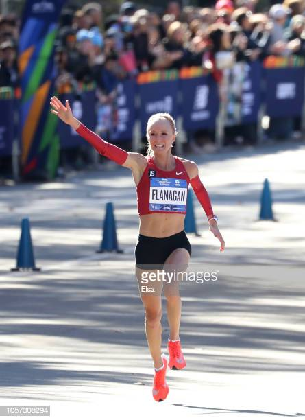 Shalane Flanagan of the USA celebrates her third place finish in the Women's Division as she crosses the finish line during the 2018 TCS New York...