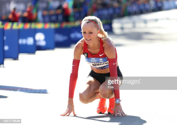 Shalane Flanagan of the USA reactts as she crosses the finish line to place third in the Women's Division during the 2018 TCS New York City Marathon...
