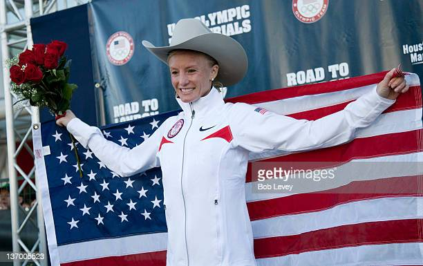 Shalane Flanagan poses with her cowboy hat and American flag after winning the US Marathon Olympic Trials on January 14 2012 in Houston Texas