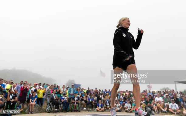 Shalane Flanagan the first American woman finisher during the 20th TD Beach to Beacon 10K Road Race strides onto the stage Saturday during an awards...