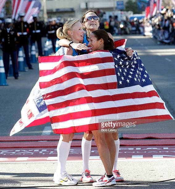 Shalane Flangan Kara Goucher and Desiree Davila have a group hug after they qualified during the US Marathon Olympic Trials on January 14 2012 in...