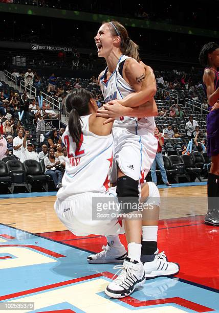 Shalee Lehning of the Atlanta Dream celebrates with teammate Armintie Price after scoring against the Phoenix Mercury at Philips Arena on June 29...