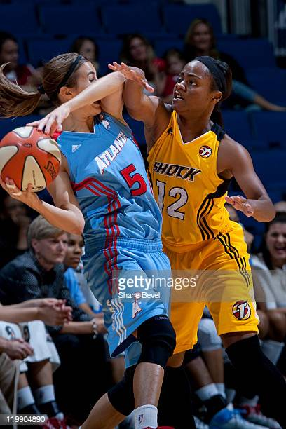 Shalee Lehning of the Atlanta Dream is trapped by Ivory Latta of the Tulsa Shock during the WNBA game on July 26 2011 at the BOK Center in Tulsa...