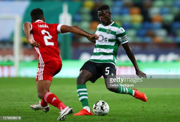 Shaleum Logan of Aberdeen looks on as Nuno Mendes of Sporting CP controls the ball during the UEFA Europa League third qualifying round match between...