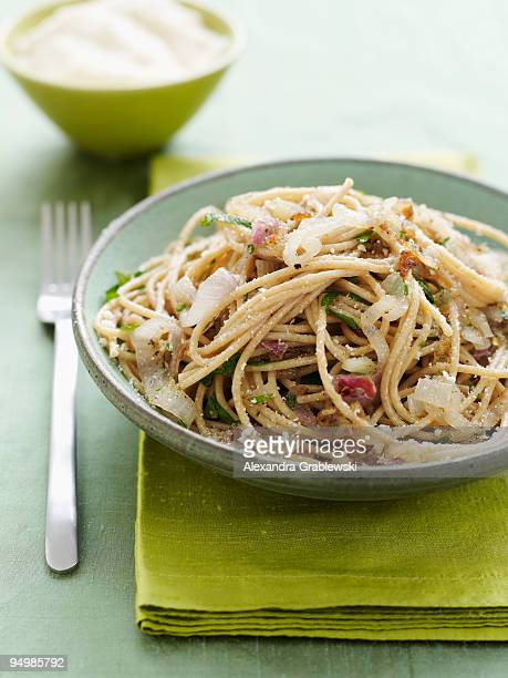 shallot spaghetti - whole wheat stock pictures, royalty-free photos & images