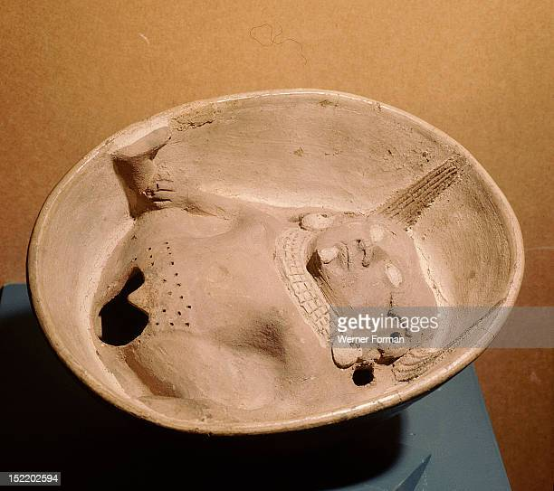 Shallow bowl with relief modelled woman at base with prominent vulva Peru