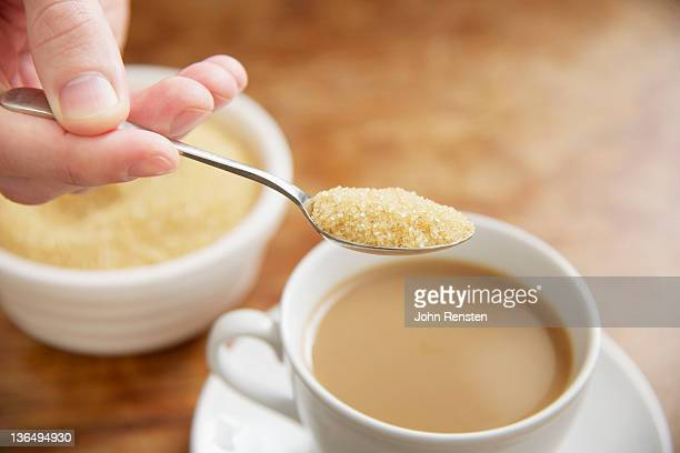 shallow focus of close up on hands - sugar bowl crockery stock photos and pictures