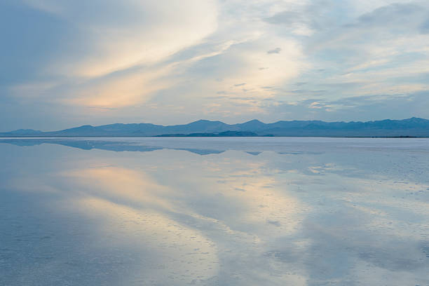 Shallow water over the surface at the Bonneville Salt Flats near Wendover, at dusk.