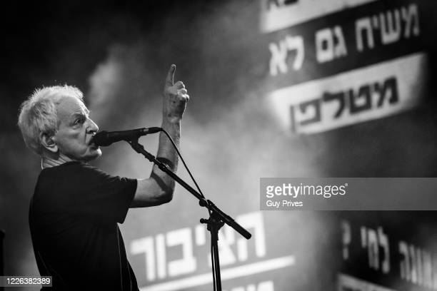 Shalom Hanoch performs at the first live concert in Israel as part of a sympathy rally with the music industry that suffered from the Corona virus...