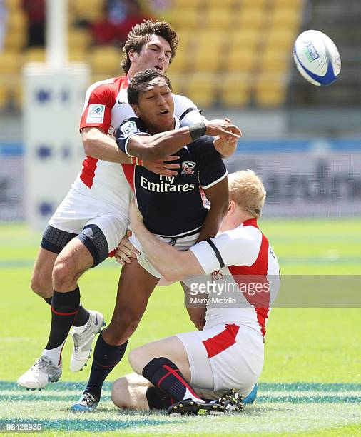 Shalom Suniula of the USA is tackled by Mathew Turner and Donald Barrell of England in the match between England and the USA during day one of the...