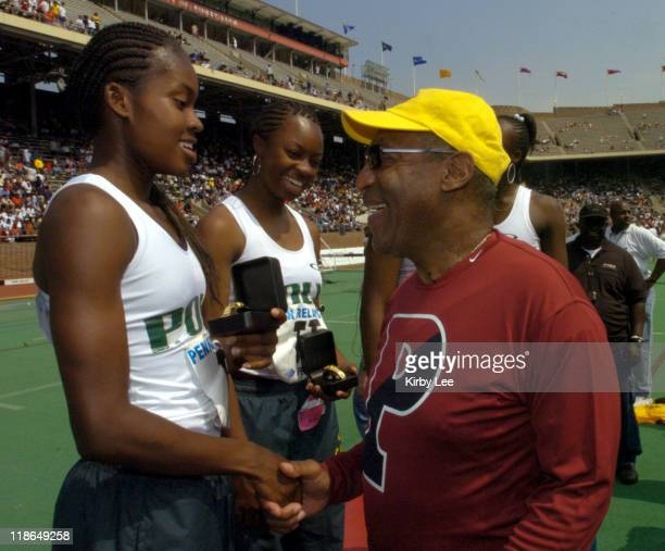 Shalonda Solomon and Chanda Picott of Long Beach Poly High are congratulated by Bill Cosby after setting a national high school record of 4450...