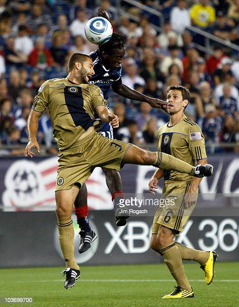 Shalrie Joseph of the New England Revolution heads the ball toward the next against the defense of Juan Diego Gonzalez and Stefani Miglioranzi of the...