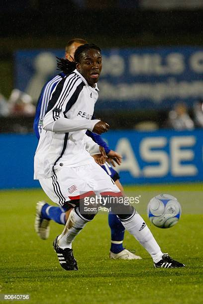 Shalrie Joseph of the New Enlgand Revolution dribbles the ball against the Kansas City Wizards during the game at Community America Ballpark on April...