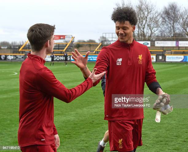 Shamal George of Liverpool with team mate Tony Gallacher during the Everton v Liverpool PL2 game on April 16 2018 in Southport England