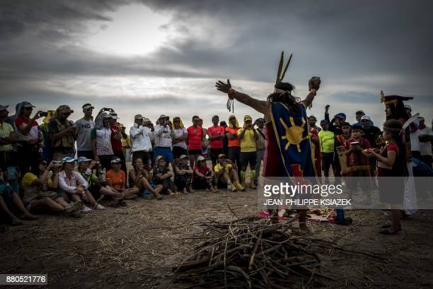 TOPSHOT A shaman implores the spirits on the eve of the start of the 1st edition of the Marathon des Sables Peru on November 27 in Cahuachi in the...