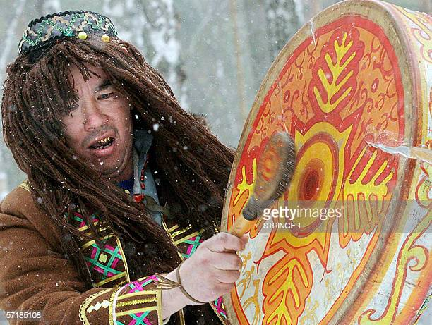 A shaman of the small northern Shortsy nation plays drums celebrating their New Year in the vernal equinox at the south of Siberian Kemerovo region...