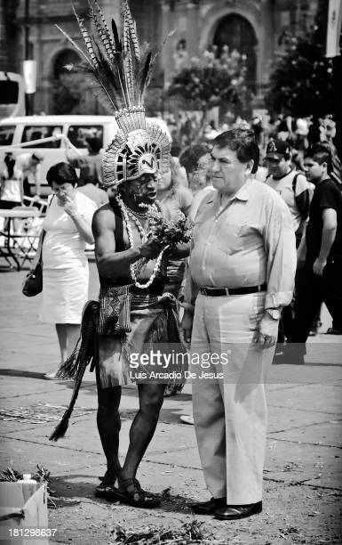 CONTENT] A shaman or brujo at the Zocalo executing a limpia or cleansing on a client It's a cleansing meant to remove a person experiencing mental...