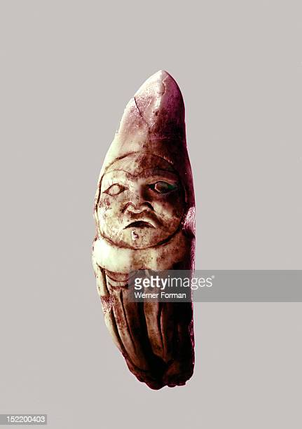 Shamans amulet carved from a bears fang These amulets represented spirits and would be attached to necklaces of sewn on to clothes Museum no 5795 39...