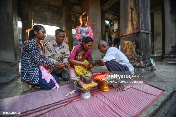 a shamans prayer of blessing for a family - my lai sit fotografías e imágenes de stock