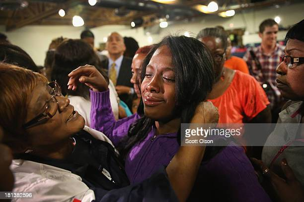 Shamarah Leggett is comforted following a prayer service at New Beginnings Church for the victims of yesterday's mass shooting on September 20 2013...