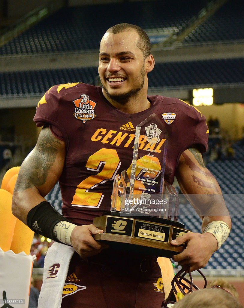 Shamari Benton #26 of the Central Michigan University Chippewas stands with his Lineman of the Game Trophy after the victory against the Western Kentucky University Hilltoppers in the Little Caesars Pizza Bowl at Ford Field on December 26, 2012 in Detroit, Michigan. The Chippewas defeated the Hilltoppers 24-21.