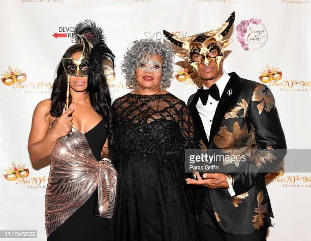 Shamari DeVoe Flo DeVoe and Ronnie DeVoe attend DeVoe Family Celebration Masquerade Gala at EpiCenter on September 27 2019 in Austell Georgia