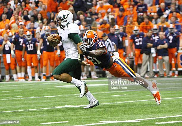 Shamarko Thomas of the Syracuse Orange tackled BJ Daniels of the South Florida Bulls during the game at the Carrier Dome on November 11 2011 in...