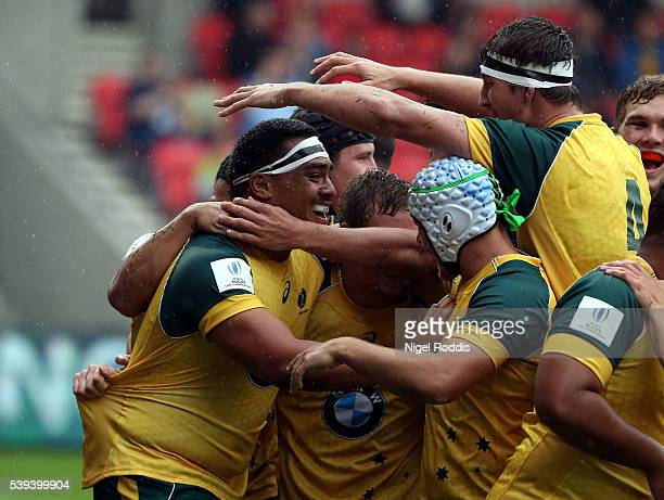 Shambeckler Vui of Australia celebrates scoring a try with teamates during the World Rugby U20 Championship match between Australia and Italy at AJ...