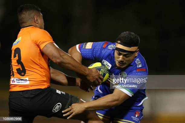 Shambeckler Vui of the Rays is tackled by Apolosi Latunipulu of the Eagles during the round one NRC match between the Sydney Rays and NSW Country...