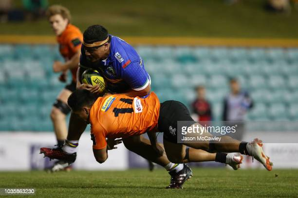 Shambeckler Vui of the Rays is tackled by Rob Buaserau of the Rays during the round one NRC match between the Sydney Rays and NSW Country Eagles at...
