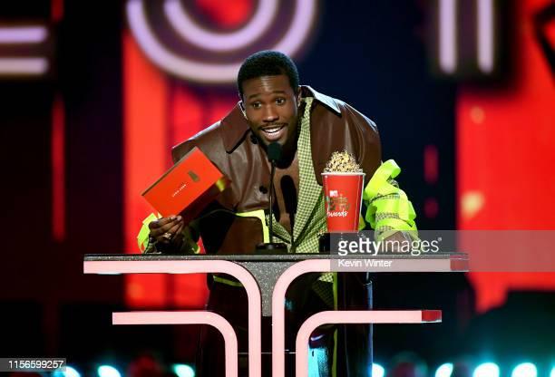 Shameik Moore presents award onstage during the 2019 MTV Movie and TV Awards at Barker Hangar on June 15 2019 in Santa Monica California