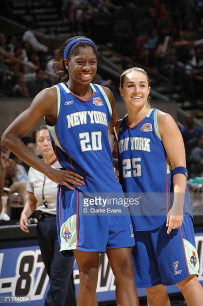 Shameka Christon and Becky Hammon of the New York Liberty is seen during the game against the San Antonio Silver Stars during the game at the ATT...