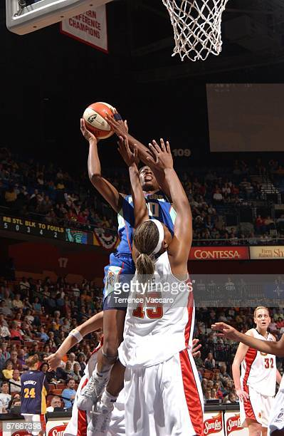 Shameka Christon of the New York Liberty goes to the basket against Asjha Jones of the Connecticut Sun at Mohegan Sun Arena on May 20 2006 in...