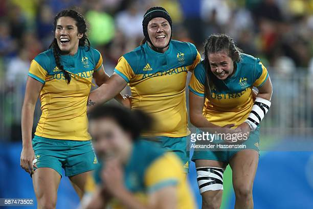 Shami Williams of Australie celebrates victory with her team mates Charlotte Caslick and Chloe Dalton after winning the Women's Gold Medal Final...
